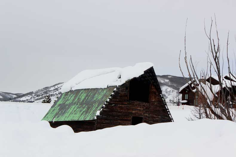 snow-covered barn in Steamboat Springs in winter