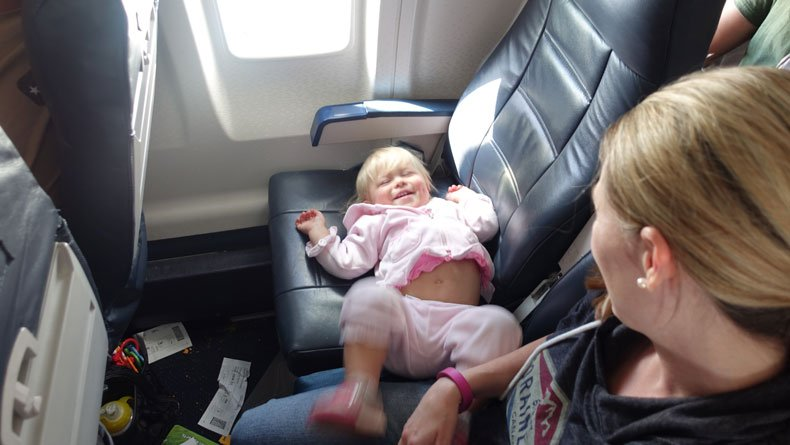 Flying with a toddler in an extra row or seat