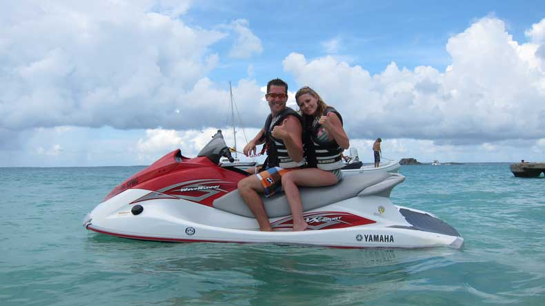 romantic getaway from the USA couple jet skiing together in Caribbean