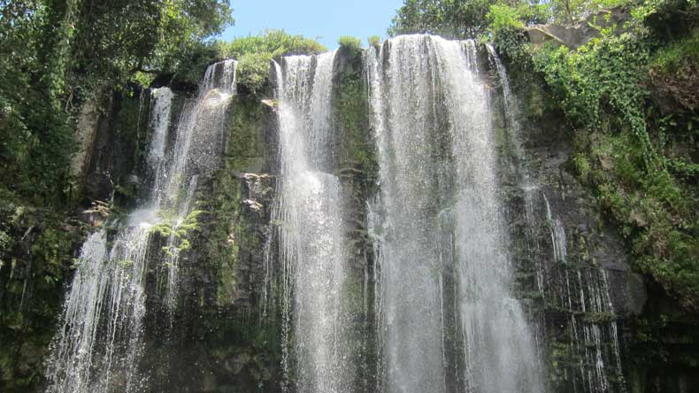 Parenthood and Passports - Llanos de Cortes waterfall