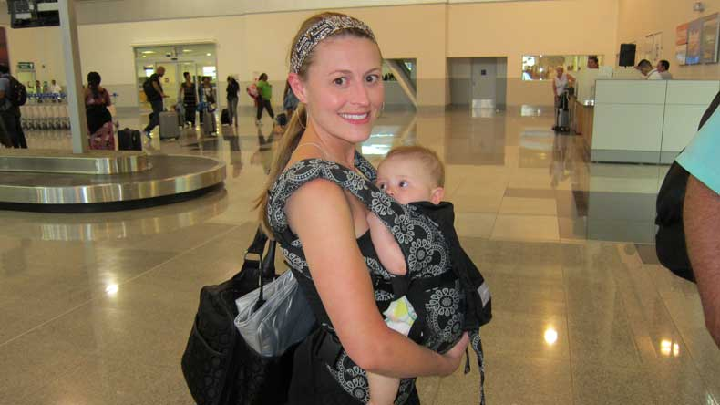 Best baby carriers for travel - Mom wearing an Ergobaby carrier at the airport