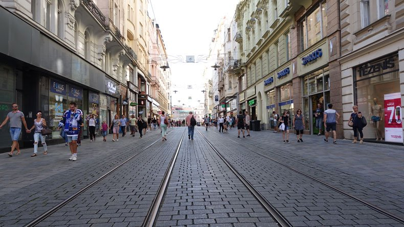 People explore some of the best things to do in Brno Czech Republic, walking through the streets of Old Town